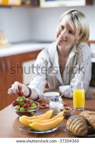 Fresh healthy breakfast with young girl in background - stock photo