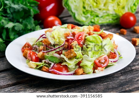 Fresh healthy Classic Caesar salad on plate - stock photo