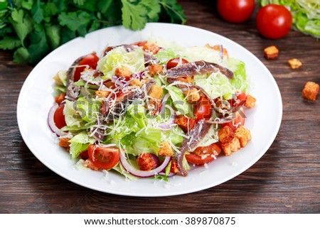 Fresh healthy Classic Caesar salad with anchovies - stock photo