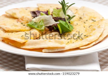 fresh healthy garlic pita bread pizza with salad on top - stock photo
