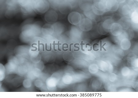 Fresh healthy green bio and eco nature theme with abstract blurred foliage and bright sunlight. Sunny bokeh nature defocused background. Selective soft focus with shallow DOF. Black and White tone. - stock photo