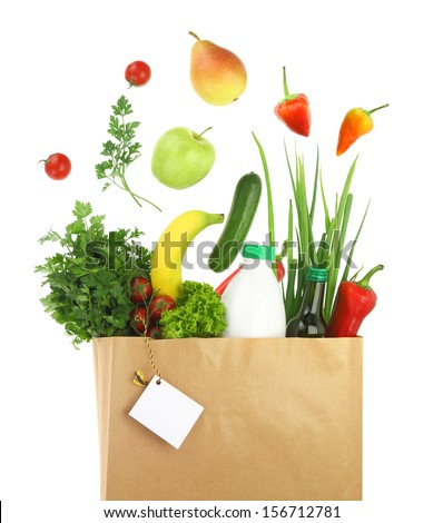 Fresh healthy groceries in a paper bag  - stock photo