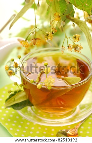 fresh healthy linden tea in glass cup - stock photo