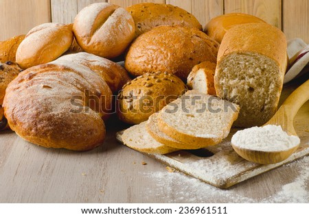 Fresh healthy natural bread on  wooden background. Selective focus - stock photo