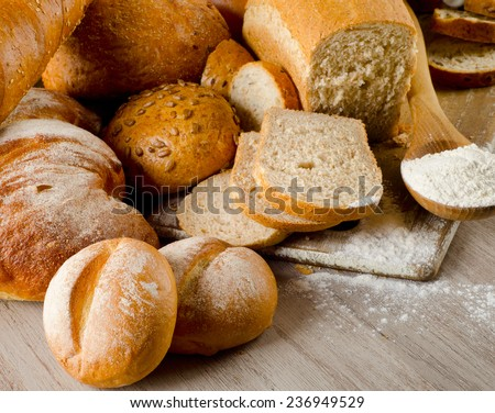 Fresh healthy natural bread on  wooden table. Selective focus - stock photo