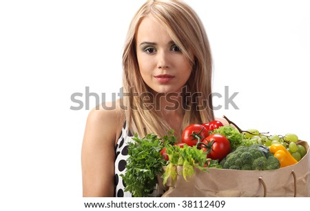 Fresh Healthy Produce. A woman holds a bags full of fresh food items.