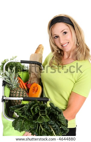 Fresh Healthy Produce.  A woman holds a basket full of fresh food items. - stock photo