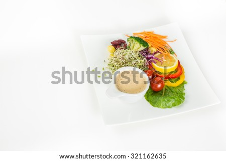 Fresh healthy salad. Delicious salad on a dish.
