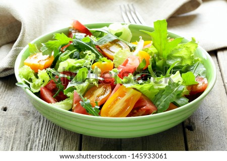 fresh healthy salad with tomatoes and arugula - stock photo