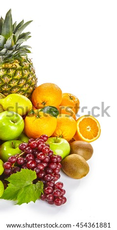 Fresh healthy tropical fruit still life forming a border isolated on white with pineapple, orange, apple, lemon, kiwi, apple and a bunch of red grapes, with copy space - stock photo