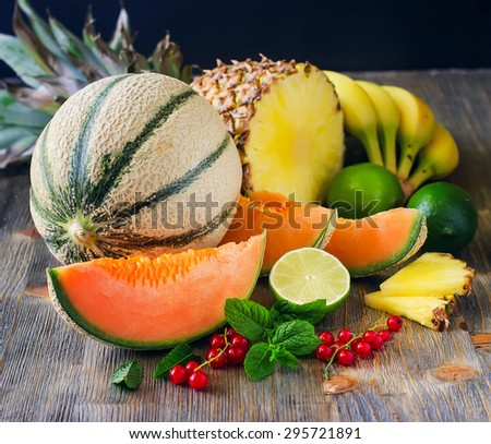 Fresh healthy tropical fruits, melon, pineapple, berries. Summer food, vitamins concept - stock photo