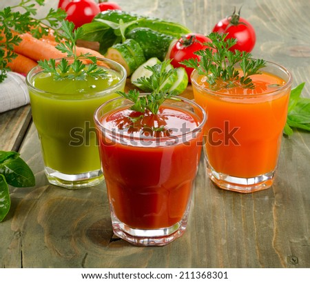 Fresh healthy vegetable  juices on a wooden table. Selective focus
