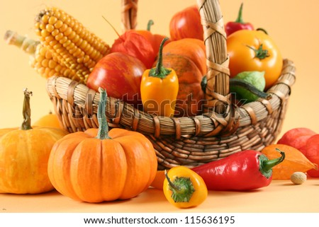 fresh healthy vegetables on yellow background - stock photo