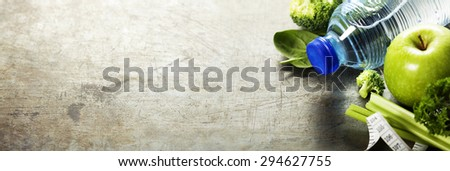 Fresh healthy vegetables, water and measuring tape. Health, sport and diet concept - stock photo