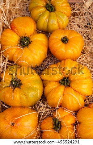 Fresh heirloom tomatoes  in the market of south France   - stock photo