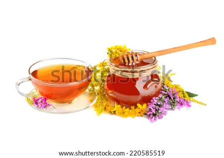Fresh herbal honey, black tea and color flowers on white background