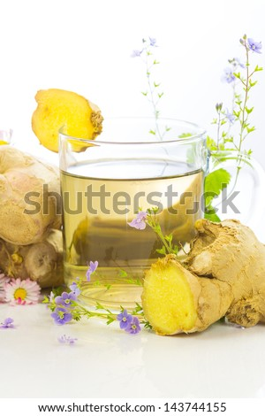 Fresh herbal tea or infusion with root ginger and herbs, used to aid weight loss and detoxifying - stock photo