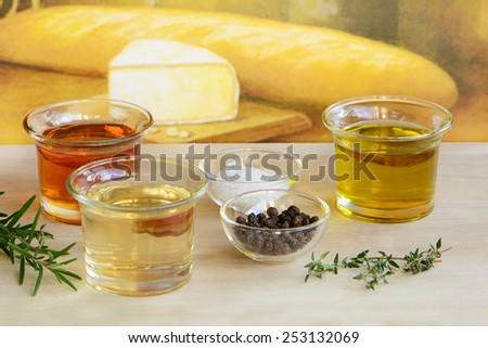 Fresh herbs, agave syrup, olive oil and rice wine vinegar with sea salt and peppercorns are the ingredients for a fresh healthy salad dressing - stock photo