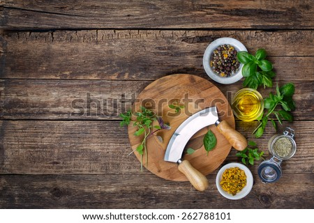 fresh herbs and spices on cutting board with a mezzaluna. Top view  - stock photo
