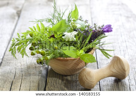 Fresh herbs and spices on vintage wooden boards closeup