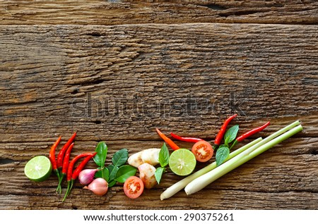 Fresh herbs and spices on wooden background - stock photo