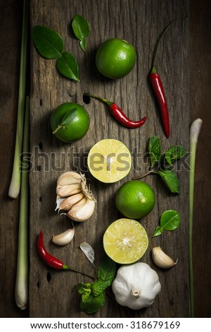 Fresh herbs and spices on wooden background, Ingredients of Thai spicy food, Ingredients of Tom yum, Still life photography with ingredients, The art of food photography with the ingredients - stock photo