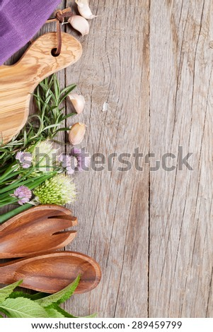 Fresh herbs and spices on wooden table. Top view with copy space - stock photo