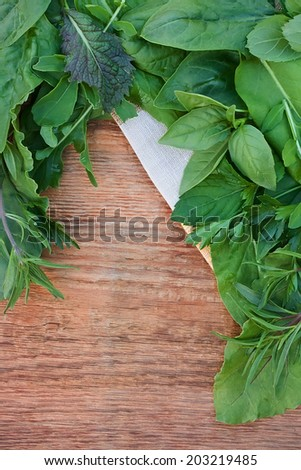 Fresh herbs on old wooden background - stock photo