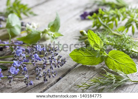 Fresh herbs on vintage boards aromatherapy background concept