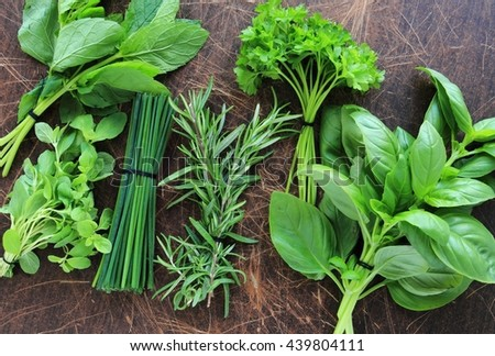 Fresh herbs on wooden rustic background - stock photo
