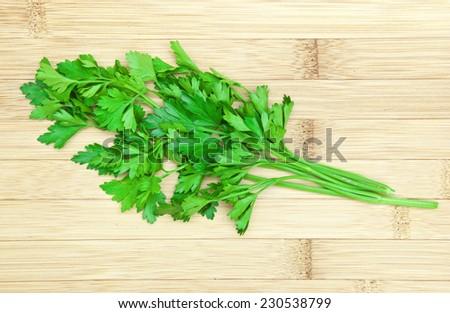 fresh herbs parsley on wooden board - stock photo
