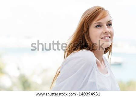 Fresh high key outdoor closeup portrait of a beautiful smiling young woman with copyspace - stock photo