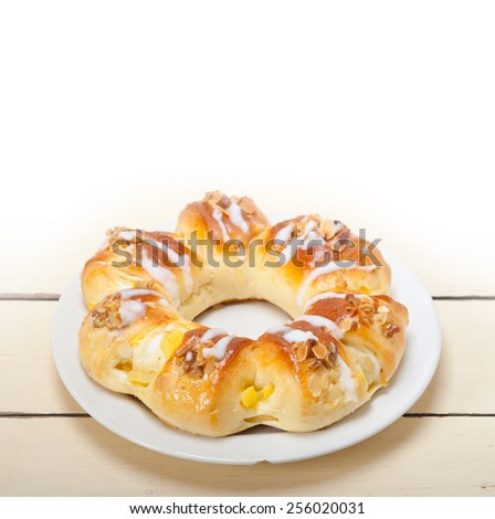 fresh home baked sweet bread donut cake with almonds and icing sugar on top - stock photo