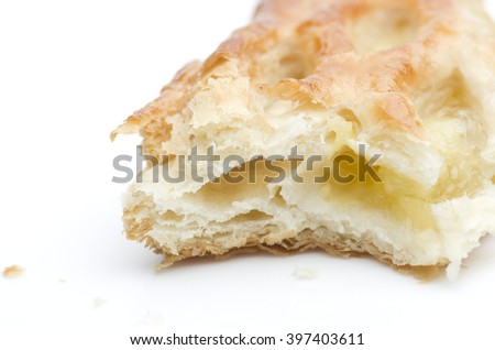Fresh home made apple strudel puff pastry isolated on a white background. - stock photo