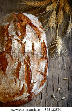 Fresh Home made Bread on old wooden table - stock photo