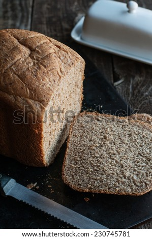 Fresh home made whole grain bread sliced - stock photo