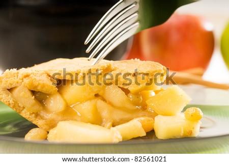 fresh homemade apple pie over green glass dish macro colseup eating  with fork - stock photo