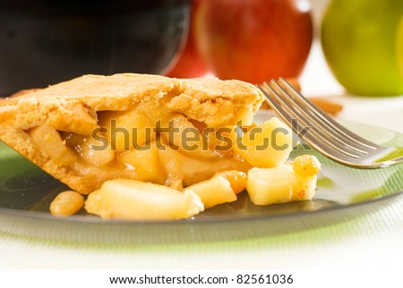 fresh homemade apple pie over green glass dish macro colseup eating  with fork - stock photo