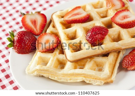 Fresh Homemade Belgium Waffles with Strawberries on top
