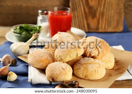 Fresh homemade bread buns from yeast dough with fresh garlic and dill, on wooden background - stock photo