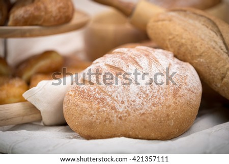 Fresh homemade bread in a cotton cloth background.