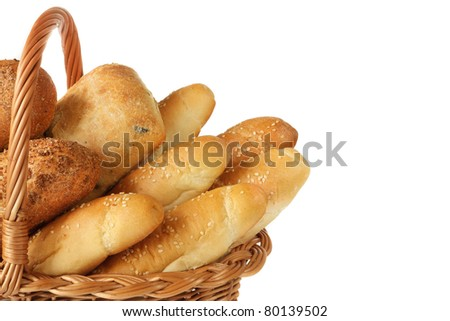Fresh homemade bread in a wicker basket. - stock photo