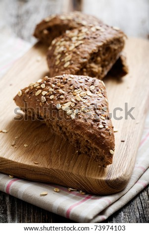 Fresh homemade bread on wooden table, selective focus - stock photo