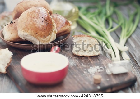 Fresh homemade bread rolls with sesam seed on table . Toned photo - stock photo