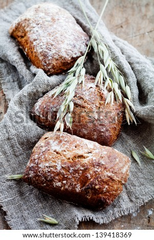 Fresh homemade bread with rye and oat - stock photo