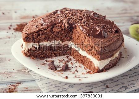 Fresh homemade chocolate cake with chocolate shavings  - stock photo