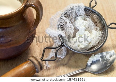Fresh homemade cottage cheese, whey is drained, but not pressed so some whey remains and the individual curds remain loose. - stock photo