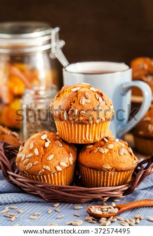 Fresh homemade delicious pumpkin muffins with sunflower seeds for breakfast - stock photo