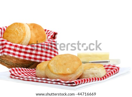 Fresh homemade dinner biscuits on a white background with copy space. - stock photo