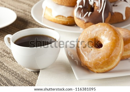 Fresh Homemade Donuts and Coffee against a background - stock photo